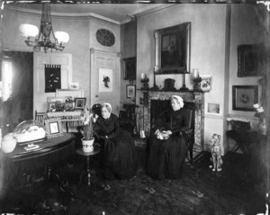 Double portrait of Misses Frances Greely Stevenson and Martha Curtis Stevenson, sitting in chairs, looking left, 32 Mount Vernon St., Boston, Mass., ca. 1895