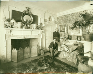 Group portrait of Arthur Little, standing, Anna Palfrey and an unidentified man in the morning room, Arthur Little House, 2 Raleigh Street, Boston, Mass., ca. 1898-1905
