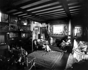 Double portrait of Ernest Wadsworth Longfellow and his wife Harriet Spelman Longfellow, sitting in their parlor, Ernest Longfellow House, Coolidge's Point, Manchester, Mass., undated