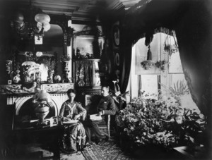 Double portrait of William and Mary Solomon, sitting in chairs in the parlor, William Solomon House, 3 Autumn St., Roxbury, Mass., ca. 1880