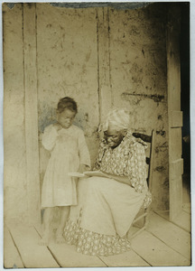 Black woman and child read together in Louisiana