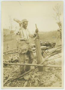 Black man splitting wood in Virginia