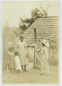 Black children meeting at a gate in Virginia