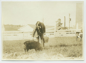 Booker T. Washington with a pig