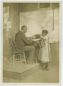 Black teacher and student in West Virginia school