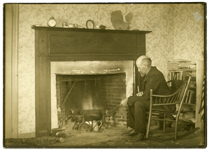 Captain Slocum by his own old fashioned fireplace