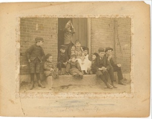 Anna McQueston and her students at the Hockanum schoolhouse