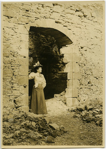 Anna McQueston Johnson standing amidst the ruins of Logie House in Scotland
