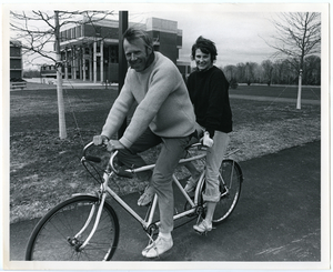 Charles and Polly Longsworth on bicycle