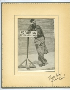 Carl Henry with 'no parking' sign