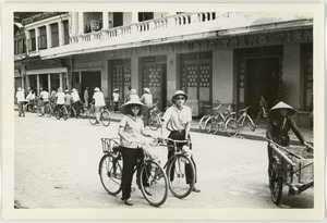Cyclists, Old Quarter shopping district