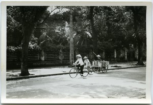 Cyclist and man hauling wagon, Old Quarter