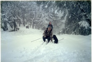 Sandi Sommer and her brother Wayne cross-country skiing with Chewie
