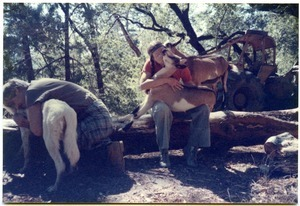 Sandi Sommer and her brother Wayne hugging animals