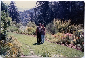 Mark and Sandi Sommer on front lawn, Salmon Creek house