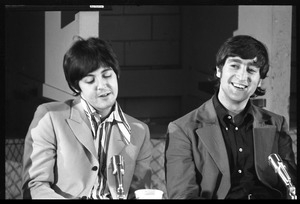 Paul Mccartney Left And John Lennon Seated At A Table During A Beatles Press Conference Digital Commonwealth