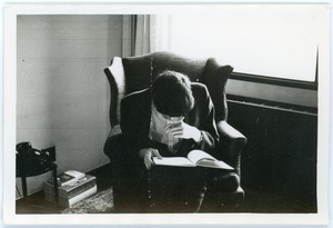 Mark Sommer seated reading