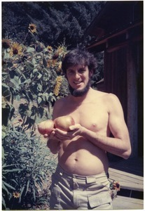 Mark Sommer holding first apples (Winter Bananas) from orchard