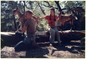 Sandi Sommer and her brother Wayne on a hike with goats