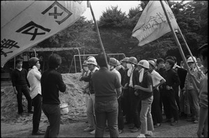 Protesters debating tactics and strategy in anti-Vietnam war demonstration