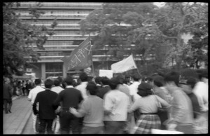 Antiwar demonstrators in serpentine dance with linked arms, downtown Tokyo