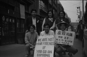 Youthful antiwar demonstrators with signs