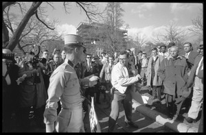 American Nazi Party counter-protester Douglas L. Niles, in uniform, walking past media and onlookers: Washington Vietnam March for Peace