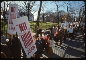 Antiwar protesters march past the white house with signs reading 'No more war, war never again': Washington Vietnam March for Peace