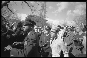 American Nazi Party counter-protester Douglas L. Niles, in uniform, escorted by police through the crowd: Washington Vietnam March for Peace