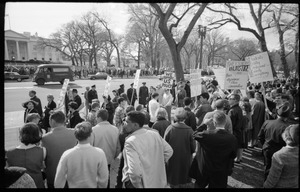 Counter-protesters in front of the White House across the street from the antiwar demonstration, carrying signs reading 'Students Wildly Indignant About Nearly Everything' [SWINE], 'We support US policy,' and 'They scream injustice and thus apease their cowardice': Washington Vietnam March for Peace