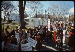 Antiwar protesters march past the White House with signs reading 'No more war, war never again' and 'Bring the GI's home now': Washington Vietnam March for Peace