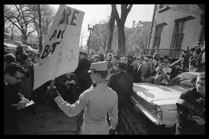 American Nazi Party counter-protester Douglas L. Niles, in uniform, holding up a sign for the crowd: Washington Vietnam March for Peace