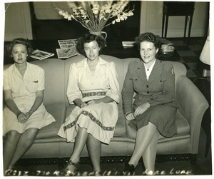 American Red Cross workers on a sofa
