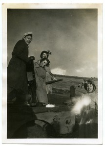 American Red Cross Clubmobilers on top of a tank