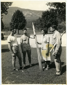 Maida L. Riggs and armed service men holding oars