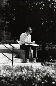 Student reading on the steps of Bapst Library at Boston College