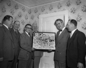 Five men posing with Thomas P. O'Neill and cartoon of Thomas P. O'Neill drawn by Joe Beesan