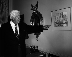 Thomas P. O'Neill pointing at painting in the Speaker's office