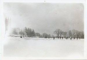 Alumni Field as ice rink with Gasson Hall in background