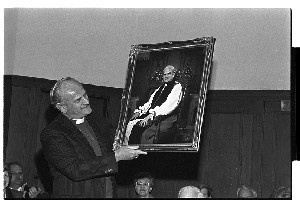 Archbishop Robin Eames Primate of Ireland, Church of Ireland admires his portrait (painting) when presented to him in Downpatrick Cathedral