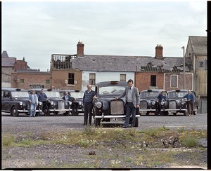 Billy McIlwaine, preacher with the Assembly of God. Shots taken at his church on the Shankill Road, Belfast. Includes four shots of drivers and black taxis on their own