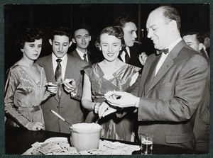 View of students at refreshment table during a social event