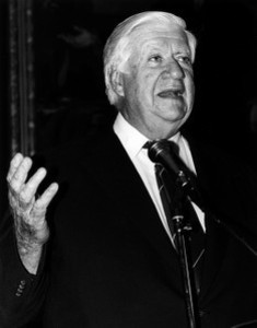 Thomas P. O'Neill speaking at a microphone, hand raised