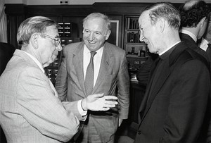 Former Congressman Edward Boland presents his papers to the Boston College Archives in the Burns Library reading room (speaking with Father Monan)