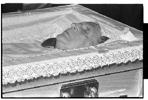 Eamon De Valera, President of Ireland. Close-up shot of De Valera lying in state in his coffin in Dublin Castle and shot of people outside Dublin Castle (including a TV camera-man) getting ready for the funeral