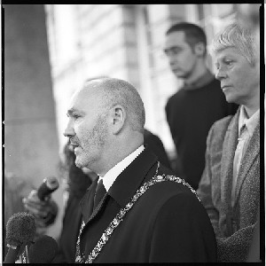 Alex Maskey, first Sinn Fein Lord Mayor of Belfast, laying a memorial wreath to commemorate the dead of two World Wars at the Cenotaph at City Hall, Belfast. A political gesture of great significance