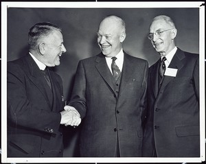 Father Joseph R.N. Maxwell, S.J. at a White House meeting with President Dwight D. Eisenhower, 1955