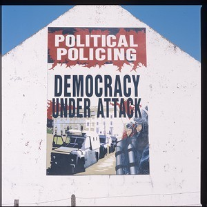 Political policing mural. On roadside, somewhere in Co. Down