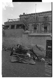 Car bomb at RUC station, Downpatrick. Shots of remains of car and of children looking at the remains of the car