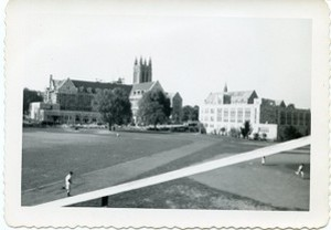 Alumni Field and stands with view of Gasson Hall, Devlin Hall, and other campus buildings